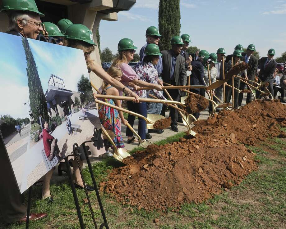 Members of the Cowden family and the Midland College board of trustees dig ceremonial dirt Monday during the groundbreaking event for the new June and Frank Cowden Jr. Dining Hall. Photo: Tim Fischer/Midland Reporter-Telegram