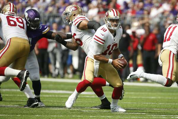 99348bf58 3of14San Francisco 49ers quarterback Jimmy Garoppolo drops back to pass  during the second half of an NFL football game against the Minnesota  Vikings