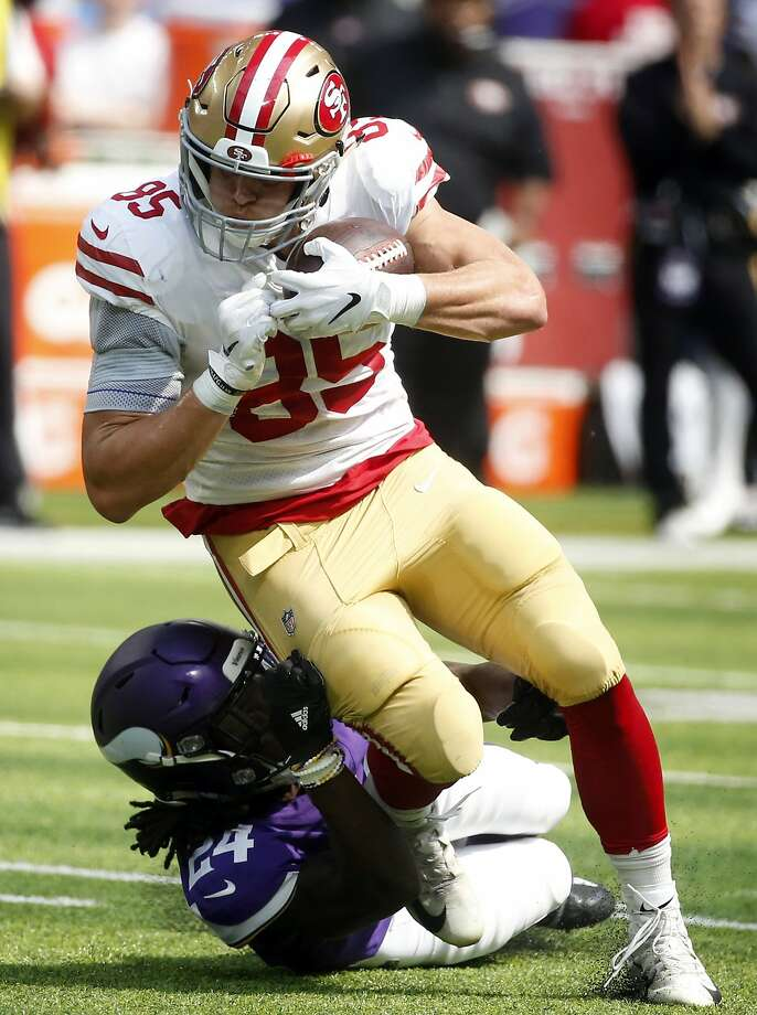 San Francisco 49ers tight end George Kittle (85) is tackled by Minnesota Vikings defensive back Holton Hill (24) after making a reception during the first half of an NFL football game, Sunday, Sept. 9, 2018, in Minneapolis. (AP Photo/Bruce Kluckhohn) Photo: Bruce Kluckhohn / Associated Press