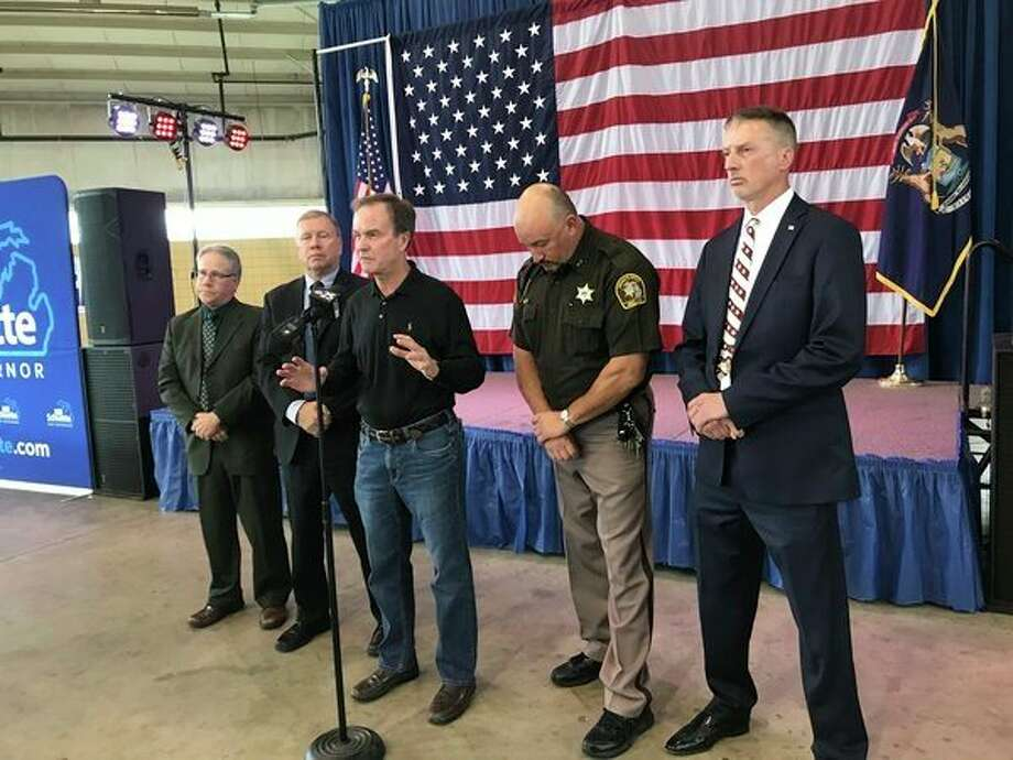 Michigan Attorney General and Republican gubernatorial nominee Bill Schuette speaks during a press conference Monday at the Midland County Fairgrounds with local Republican law enforcement officials to 'issue a public safety warning' against his Democratic opponent's stance on immigration. (Kate Carlson/kcarlson@mdn.net)
