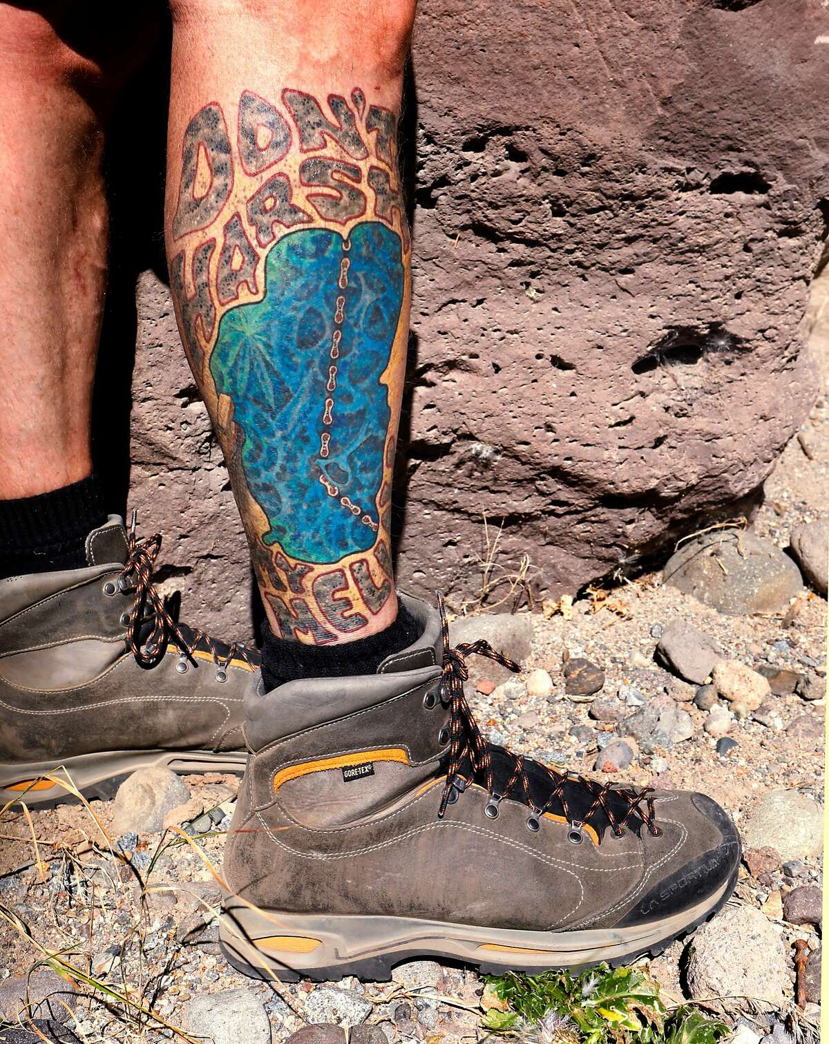 Mike Dewey of Reno, Nv. displays his Lake Tahoe tattoo, done by Mark of Truth Tattoo in Truckee, Calif., during a hike along the Tahoe-Pyramid Bikeway between Floriston and Farad, Calif., as seen on Thurs. Sept. 6, 2018.