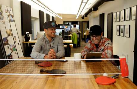 Chris McNamara (left) of Outdoor Gear Lab Services and Corey Rich of Novus Select inside the renovated headquarters building of Novus Select headquarters on Ski Run Boulevard. Photo: Michael Macor / Special To The Chronicle