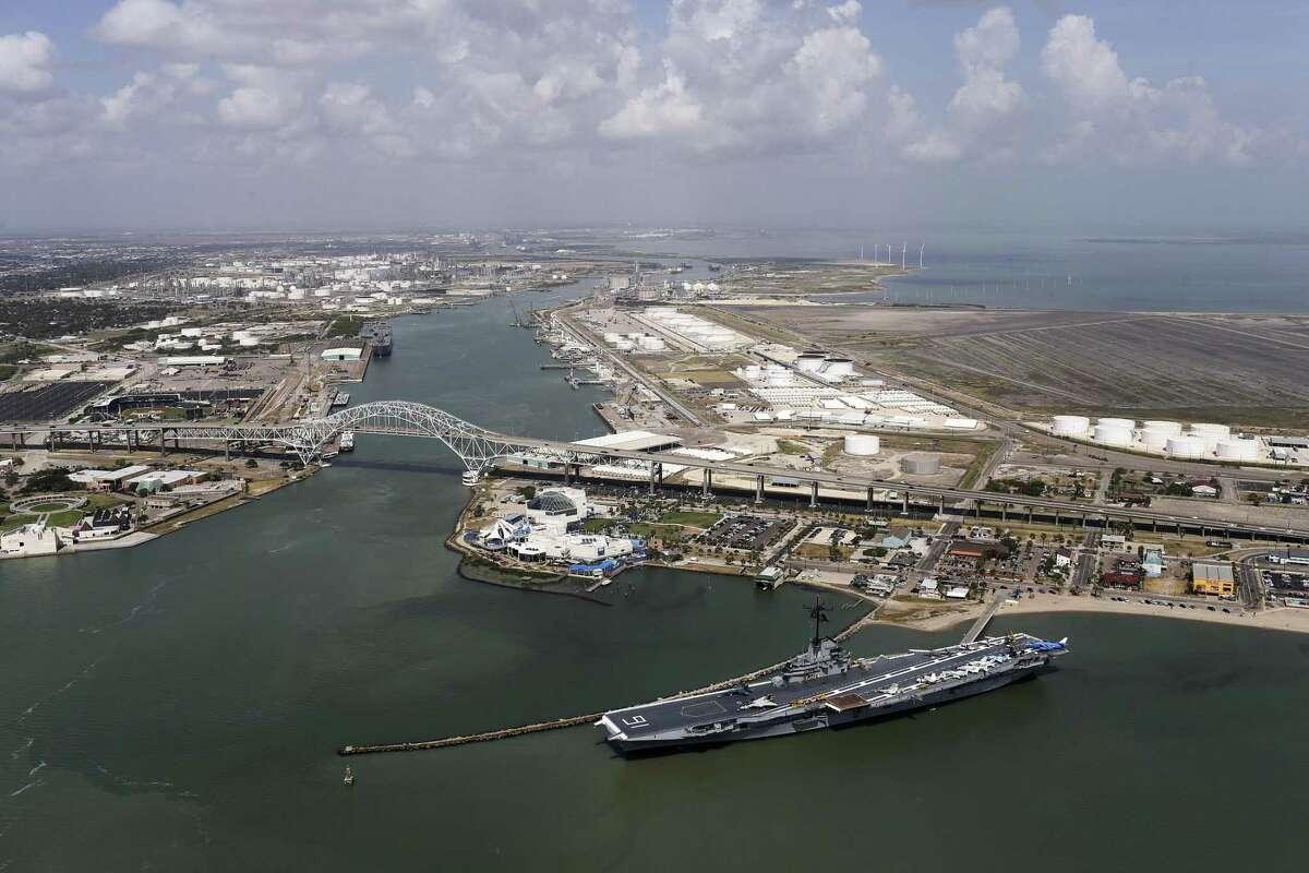 The USS Lexington dominates the view by the Harbor Bridge and the Texas State Aquarium in Corpus Christi, Texas, Tuesday, Aug. 8, 2017.