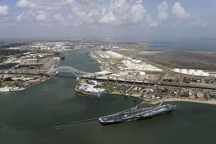 The USS Lexington dominates the view by the Harbor Bridge and the Texas State Aquarium in Corpus Christi, Texas, Tuesday, Aug. 8, 2017.