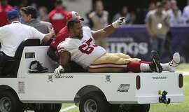 San Francisco 49ers offensive guard Joshua Garnett is carted off the field after getting injured during the second half of an NFL football game against the Minnesota Vikings, Sunday, Sept. 9, 2018, in Minneapolis. (AP Photo/Jim Mone)