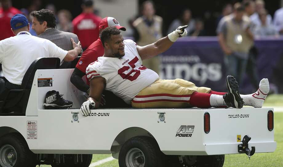 San Francisco 49ers offensive guard Joshua Garnett is carted off the field after getting injured during the second half of an NFL football game against the Minnesota Vikings, Sunday, Sept. 9, 2018, in Minneapolis. (AP Photo/Jim Mone) Photo: Jim Mone / Associated Press