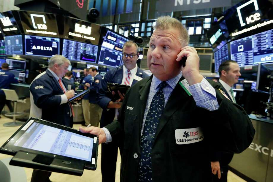 FILE- In this Aug. 27, 2018, file photo trader George Ettinger, foreground, works on the floor of the New York Stock Exchange. The U.S. stock market opens at 9:30 a.m. EDT on Monday, Sept. 10. (AP Photo/Richard Drew, File) Photo: Richard Drew / Copyright 2018 The Associated Press. All rights reserved