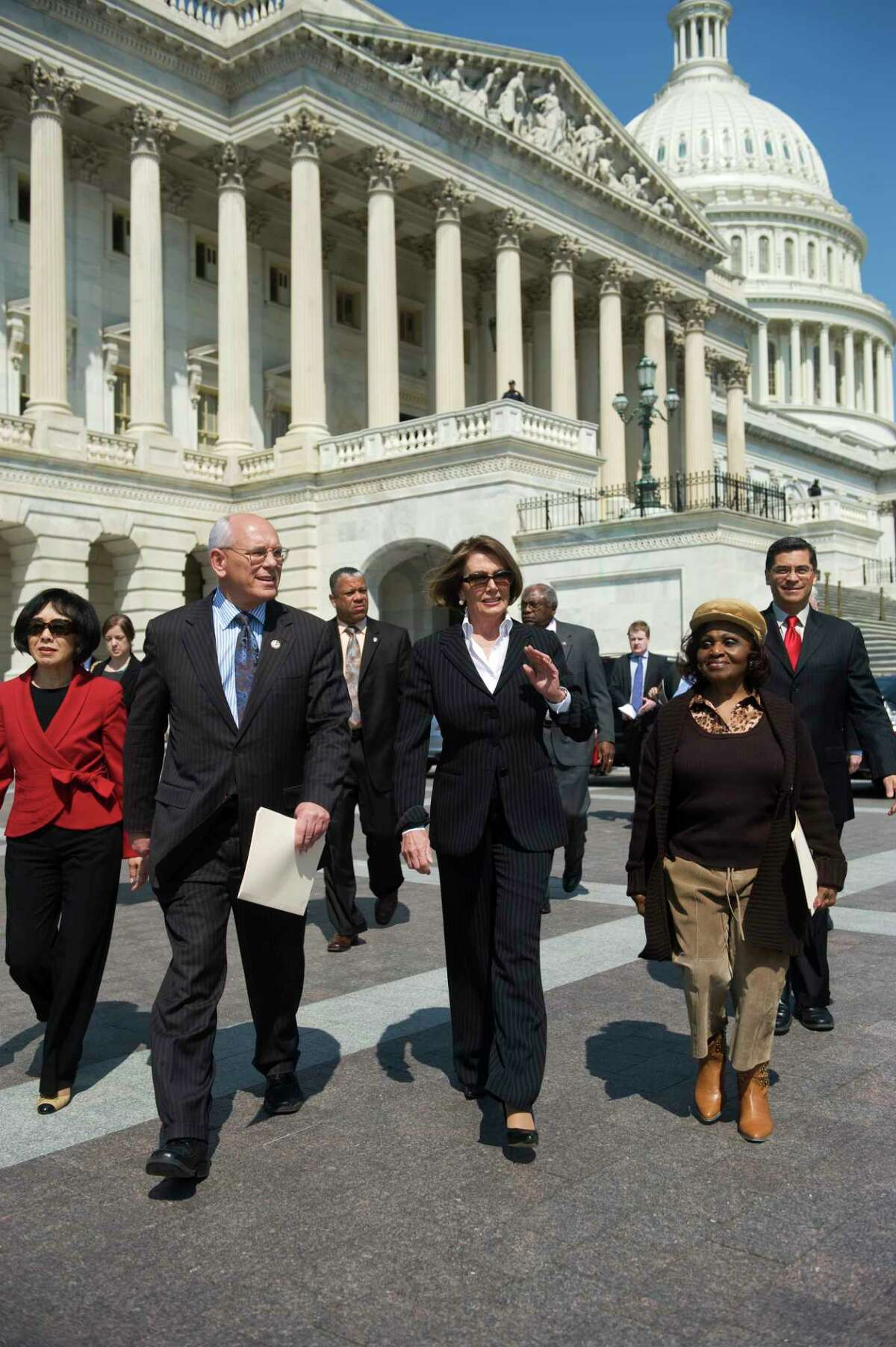 UNITED STATES - APRIL 15: From left, Reps. Doris Matsui, D-Calif., Paul Tonko, D-N.Y., House Minority Leader Nancy Pelosi, D-Calif., Assistant Leader James Clyburn, D-S.C., Josephine Ball-Sivell, a retiree living on Social Security and Medicare, and Democratic Caucus Vice Chair Xavier Becerra, D-Calif., make their way to a news conference at the house triangle to contend that the House Republican budget would