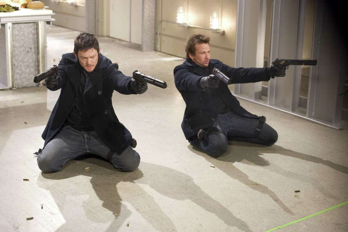 """Norman Reedus, left, and Sean Patrick Flanery are shown in a scene from """"The Boondock Saints II: All Saints Day."""""""