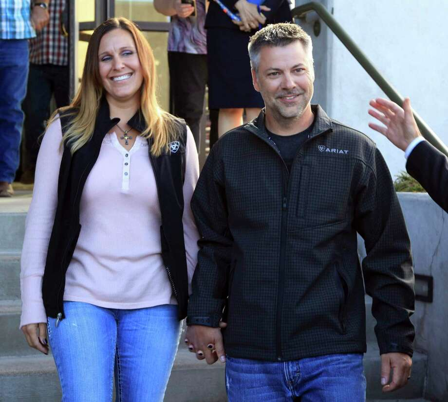 This photo provided by the Oregon Justice Resource Center shows Josh Horner with his wife Kelli Horner after a hearing in Bend, Ore., Monday, Sept. 10, 2018. A 50-year sentence in a sex abuse case against Horner was dismissed Monday by Deschutes County District Attorney John Hummel after the Oregon Innocence Project found holes in the 2017 conviction that undermined the credibility of the complainant, including that Horner had shot the dog in front of her. (Jenny Coleman/Oregon Justice Resource Center via AP) Photo: Jenny Coleman, AP / OREGON JUSTICE RESOURCE CENTER