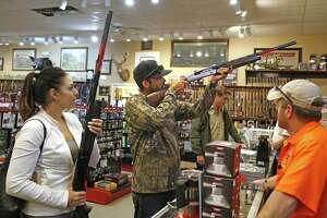 Elisa and Anthony Peiffer, husband and wife, shop for shotgun for bird season at Ranger Firearms. Edward E. DeWees III, owner of Ranger Firearms said his sales have been going great contrary to the Trump Slump where firearms have fallen since the percentile election. Photos taken on Monday, September 10, 2018 at Ranger Firearms