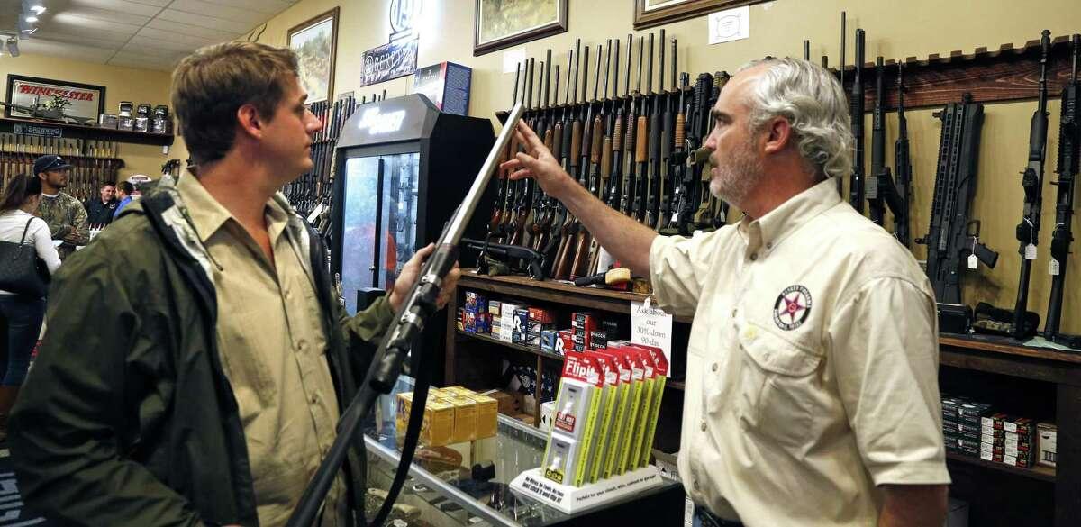 Edward E. DeWees III shows Hutner Barrett a gun.