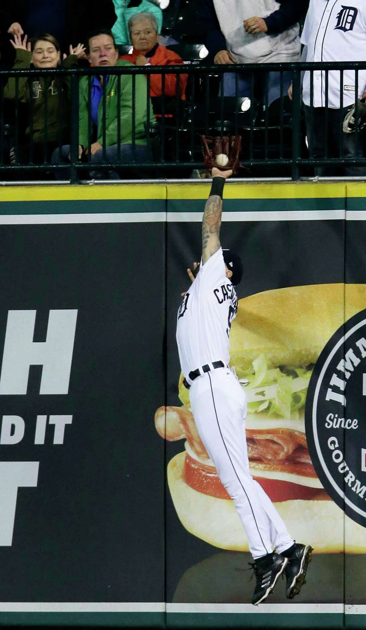 Detroit Tigers right fielder Nicholas Castellanos catches a fly ball hit by Houston Astros' Marwin Gonzalez during the eighth inning of a baseball game, Monday, Sept. 10, 2018, in Detroit. (AP Photo/Duane Burleson)