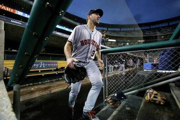 Houston Astros starting pitcher Justin Verlander heads back to the field for the seventh inning of a baseball game against the Detroit Tigers , Monday, Sept. 10, 2018, in Detroit. (AP Photo/Duane Burleson)
