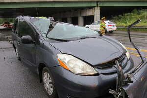 A woman was injured Monday evening, Sept. 10, 2018, when a tractor trailer driving on Route 9W in Bethlehem, N.Y., slammed into a Thruway overpass and dropped an empty cargo box on her minivan, fire officials said.