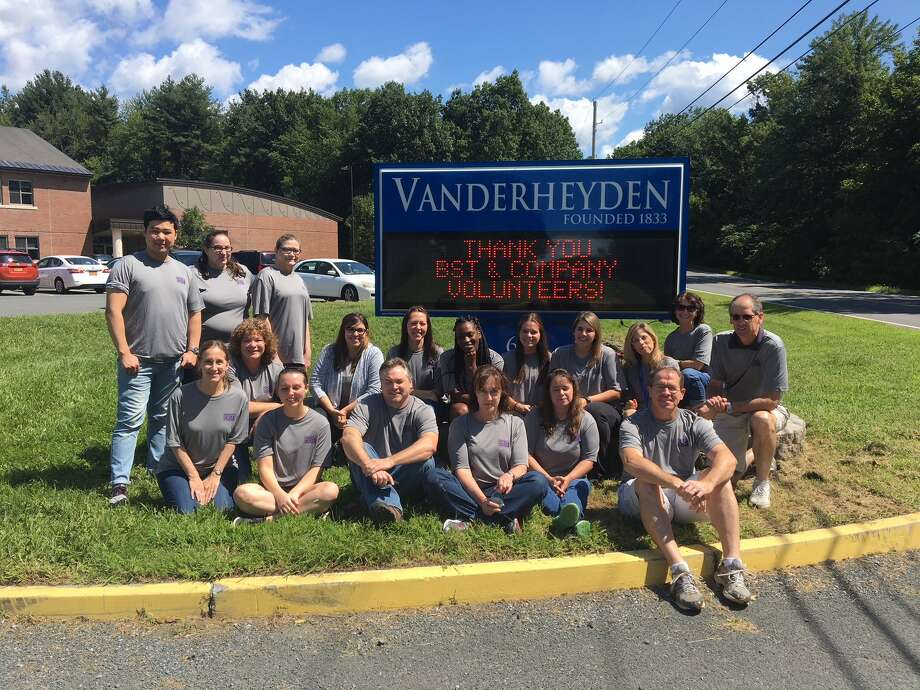 BST & Company CPAs, LLP in Albany took time out of their regular jobs to give back to the community, spending hours cleaning classrooms, lockers and the cafeteria at The Richard A. Desrochers Educational Center at Vanderheyden in Wynantskill. (Submitted photo)
