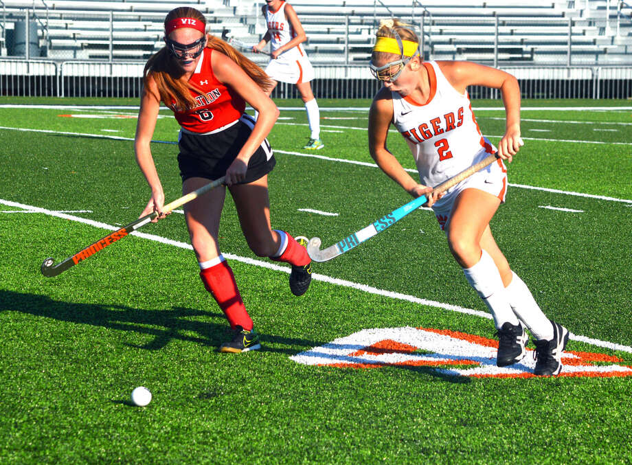 Edwardsville sophomore Rachel Goebel, right, tries to get past a Visitation Academy defender during Monday's game at the District 7 Sports Complex. Photo: Scott Marion