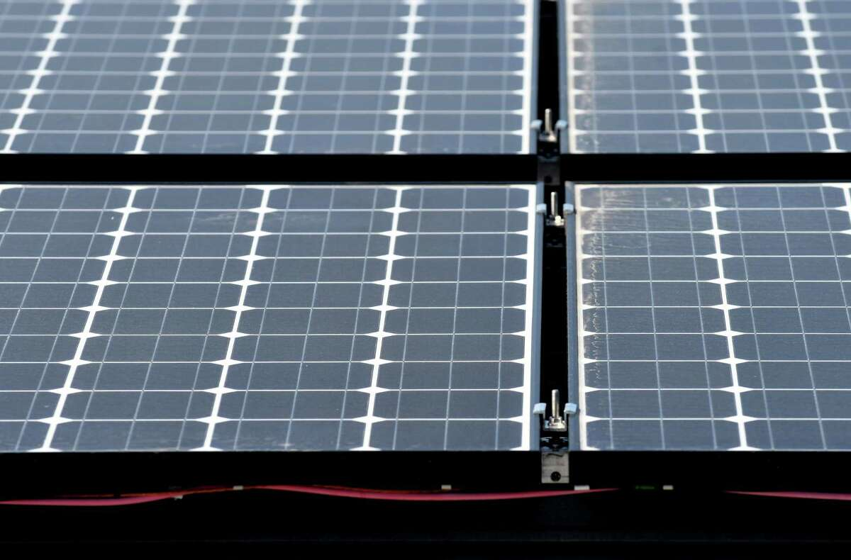 Panels for a solar array on the roof of Dimension Fabricators on Thursday, Aug. 3, 2017, in Glenville, N.Y. Clifton Park is studying locating solar farms, and Glenville passed a new law allowing them on 30-plus acres in 2021. (Will Waldron/Times Union)