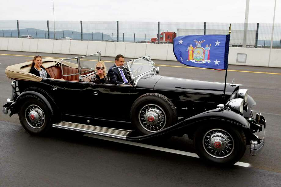 New York Gov. Andrew Cuomo drives a 1932 Packard as his girlfriend, TV chef Sandra Lee, blows a kiss as they cross the Gov. Mario M. Cuomo Bridge, Friday, Sept. 7, 2018, in Nyack, N.Y. Cuomo officially opened the second span of the new Hudson River Bridge that bears his father's name. (AP Photo/Mark Lennihan) Photo: Mark Lennihan / Copyright 2018 The Associated Press. All rights reserved.