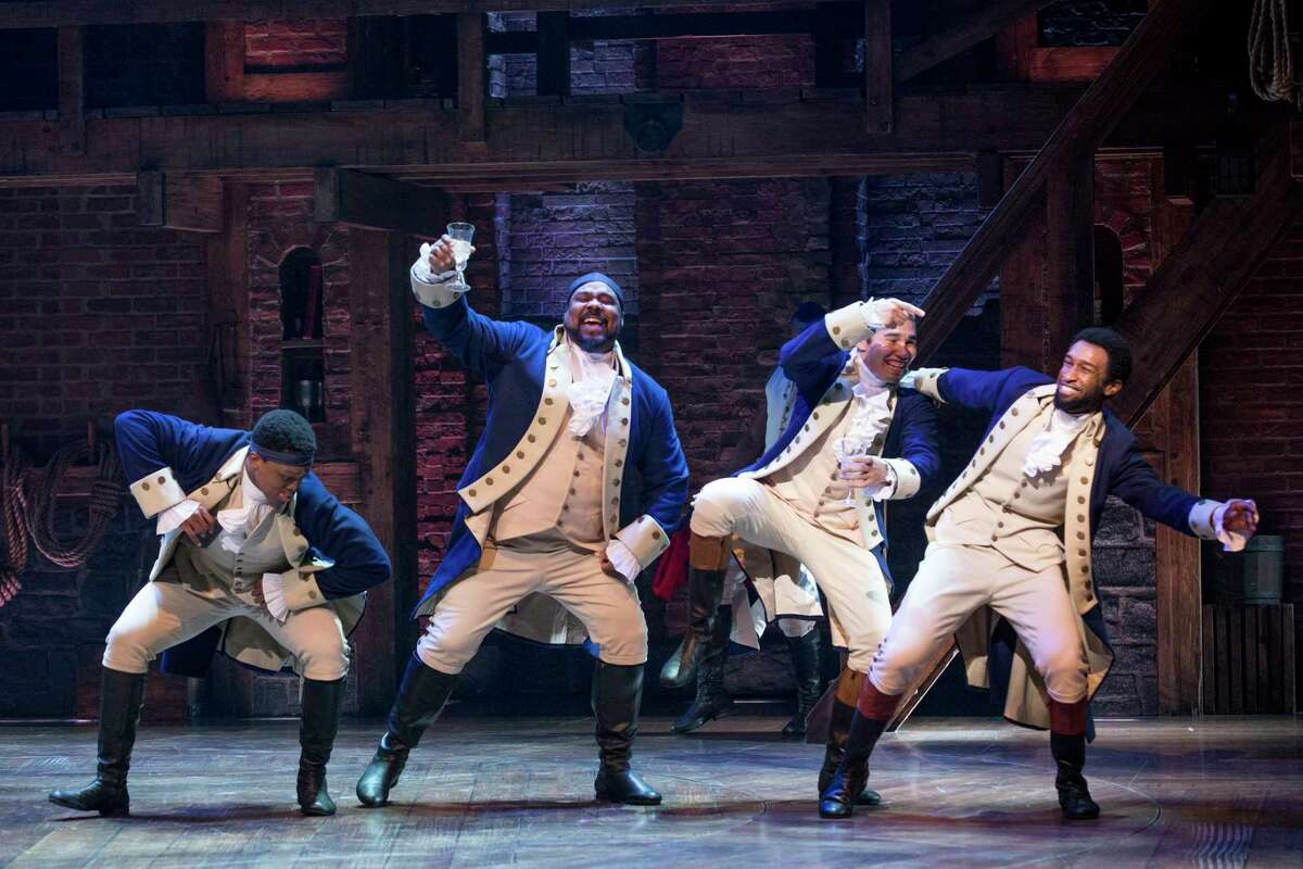 """FILE -- From left: J. Quinton Johnson, James Monroe Iglehart, Anthony Lee Medina and Donald Webber, Jr. in the musical """"Hamilton"""" at the Richard Rodgers Theater in New York, May 4, 2017. Premium prices for hot Broadway shows N especially those with limited runs or popular stars, like """"Hamilton, nearing the end of their runs N have been climbing as producers try to claim for their investors and artists some of the revenue now going to resellers. (Sara Krulwich/The New York Times) ORG XMIT: XNYT22"""