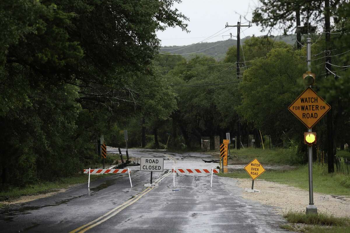 Barricades are in place on Scenic Loop Road near Gray Forest on Sunday. Heavy rains caused flooding leading to the closures of all of the roads in Grey Forest.