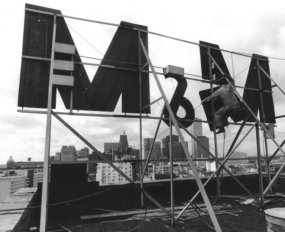 From the February 1971 Houston Chronicle: As a first step in renovating the M&M Building as the campus of South Texas Junior College, the old sign which has looked over the city from across Buffalo Bayou for many years comes down.  Dee Pool for Federal Sign and Signal company here applies block and tackle to remove the monster by sections.  The college is now in a campaign to raise $2 million for capital improvements. Photo: Tom Colburn/Houston Chronicle