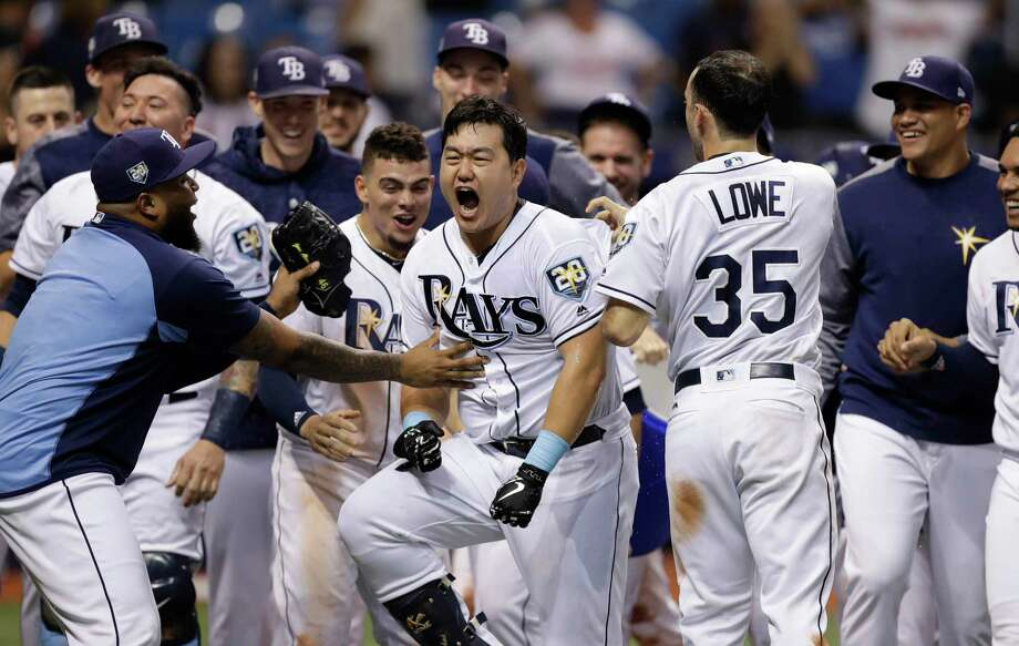 Tampa Bay Rays' Ji-Man Choi, of South Korea, center, celebrates his two-run walk-off home run off Cleveland Indians pitcher Brad Hand during the ninth inning of a baseball game Monday, Sept. 10, 2018, in St. Petersburg, Fla. (AP Photo/Chris O'Meara) Photo: Chris O'Meara / Copyright 2018 The Associated Press. All rights reserved.