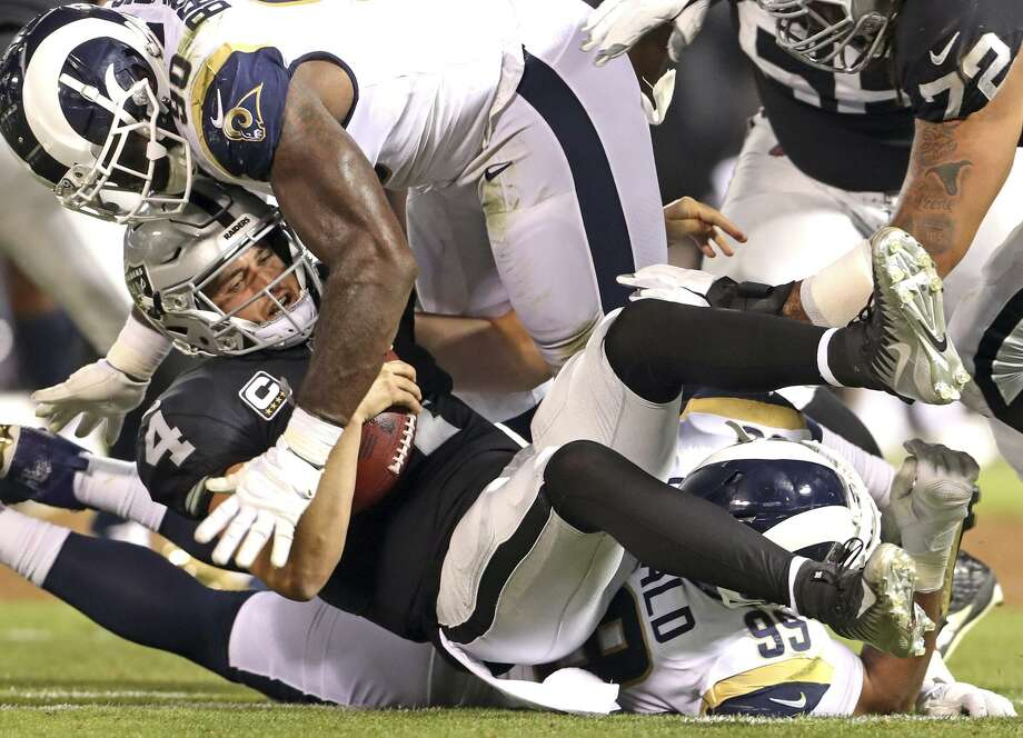 Los Angeles Rams' Aaron Donald (99) commits a personal foul while sacking Oakland Raiders' Derek Carr in 1st quarter during NFL game at Oakland Coliseum in Oakland, Calif. on Monday, September 10, 2018. Photo: Photos By Scott Strazzante / The Chronicle / San Francisco Chronicle