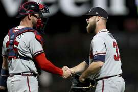 Atlanta Braves relief pitcher A.J. Minter (33) is congratulated by catcher Tyler Flowers (25) after the 4-1 victory over the San Francisco Giants in a baseball game in San Francisco, Monday, Sept. 10, 2018. (AP Photo/Scot Tucker)