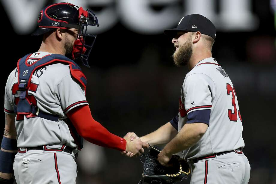 Atlanta Braves relief pitcher A.J. Minter (33) is congratulated by catcher Tyler Flowers (25) after the 4-1 victory over the San Francisco Giants in a baseball game in San Francisco, Monday, Sept. 10, 2018. (AP Photo/Scot Tucker) Photo: Scot Tucker / Associated Press