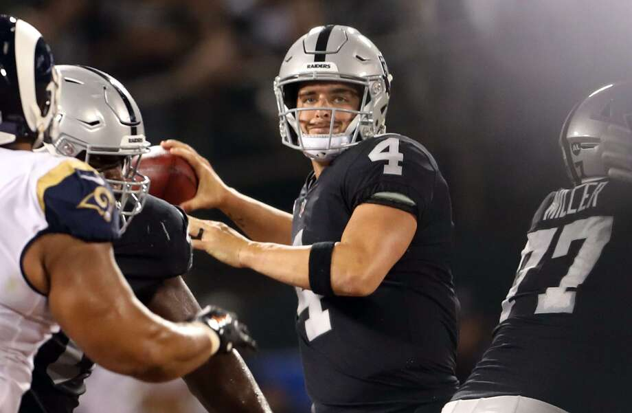 Oakland Raiders' Derek Carr looks to pass in 2nd quarter against Los Angeles Rams during NFL game at Oakland Coliseum in Oakland, Calif. on Monday, September 10, 2018. Photo: Scott Strazzante / The Chronicle / San Francisco Chronicle
