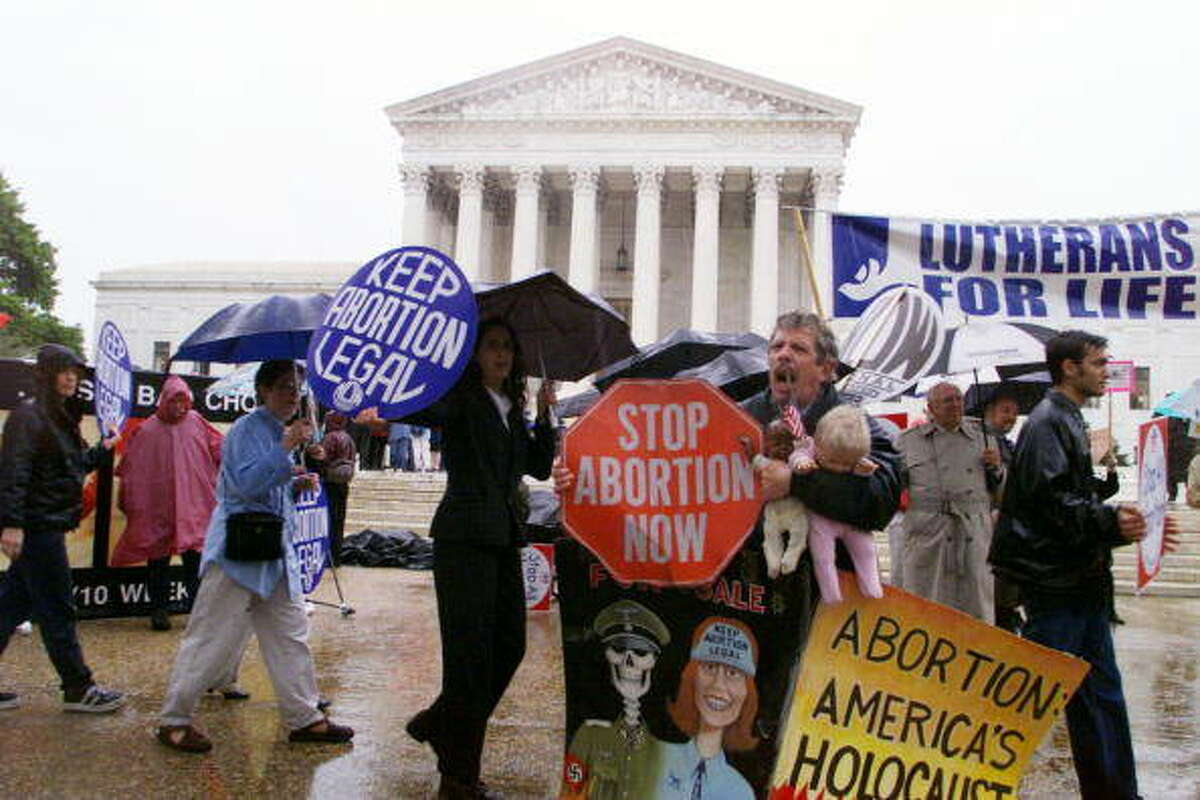 Pro-choice and anti-abortion activists demonstrate in front of the Supreme Court building. Harry Hamburg | NY Daily News Archive (Getty Images)