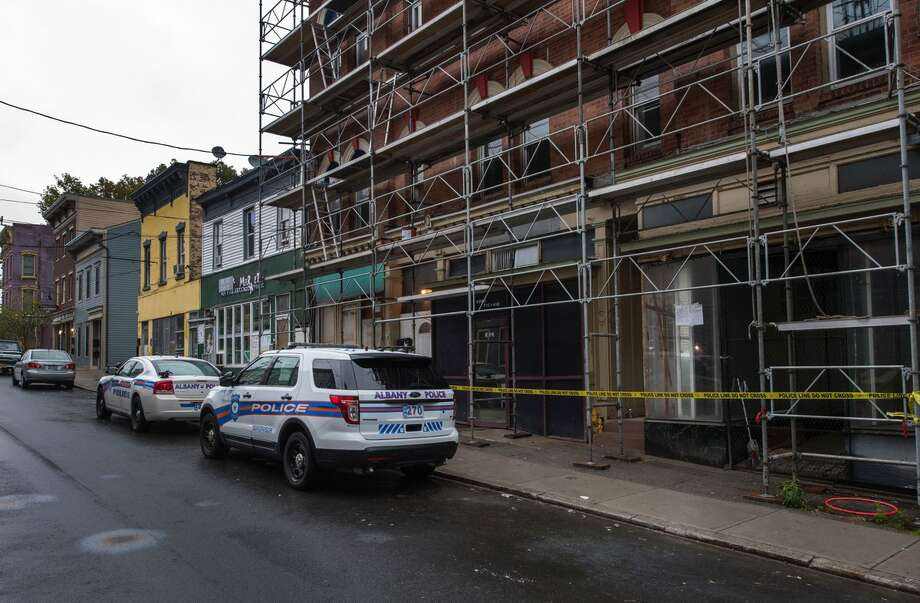 Albany police are investigating a shooting inside this building that officers said left a man with serious injuries early Tuesday. Photo: Skip Dickstein / Times Union