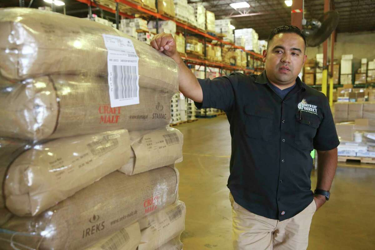 Johnson Brothers Bakery Supply and Brewery Direct Vice-President Jesse R. Reyes, checks out bags of German malts at the company's warehouse, Tuesday, August 28, 2018. Brewery Directs is a supplier for craft beer brewers in Texas, Oklahoma and Arkansas that is expanding to the New York tri-state region, Upper Midwest and Ontario.