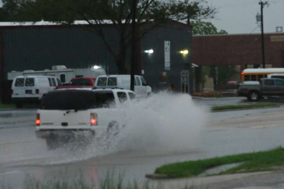 Flooding south of Houston slowed traffic and closed a school district and a college campus. Photo: Kirk Sides/Houston Chronicle