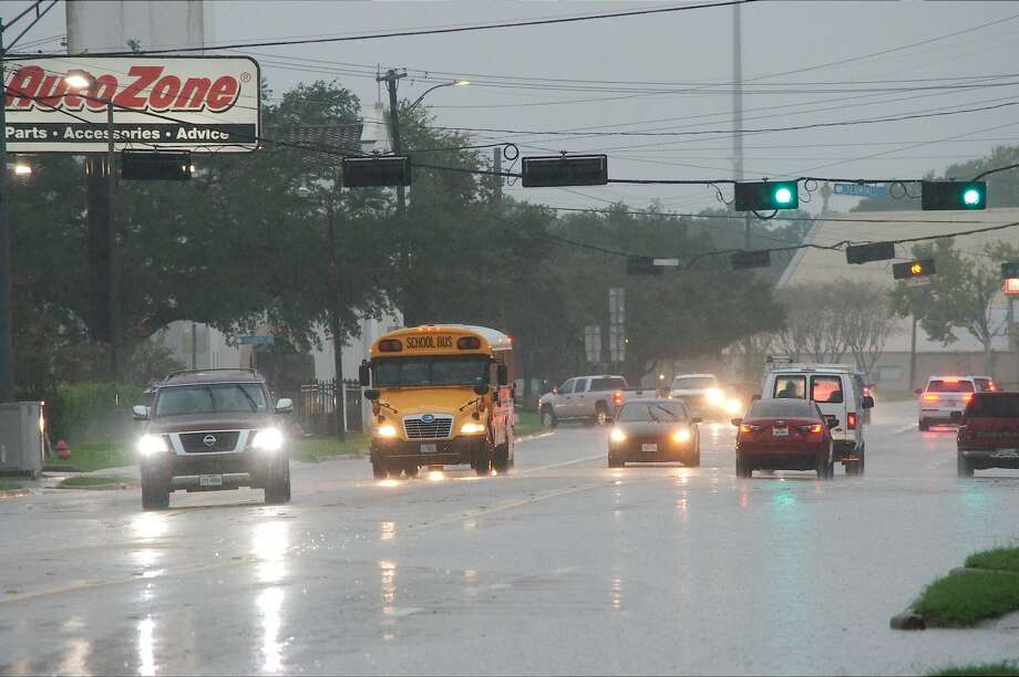 High water at Highway 3 at FM 517 slows traffic in Dickinson on Tuesday, Sept. 11, 2018. The water later cleared. Photo: Kirk Sides/Houston Chronicle