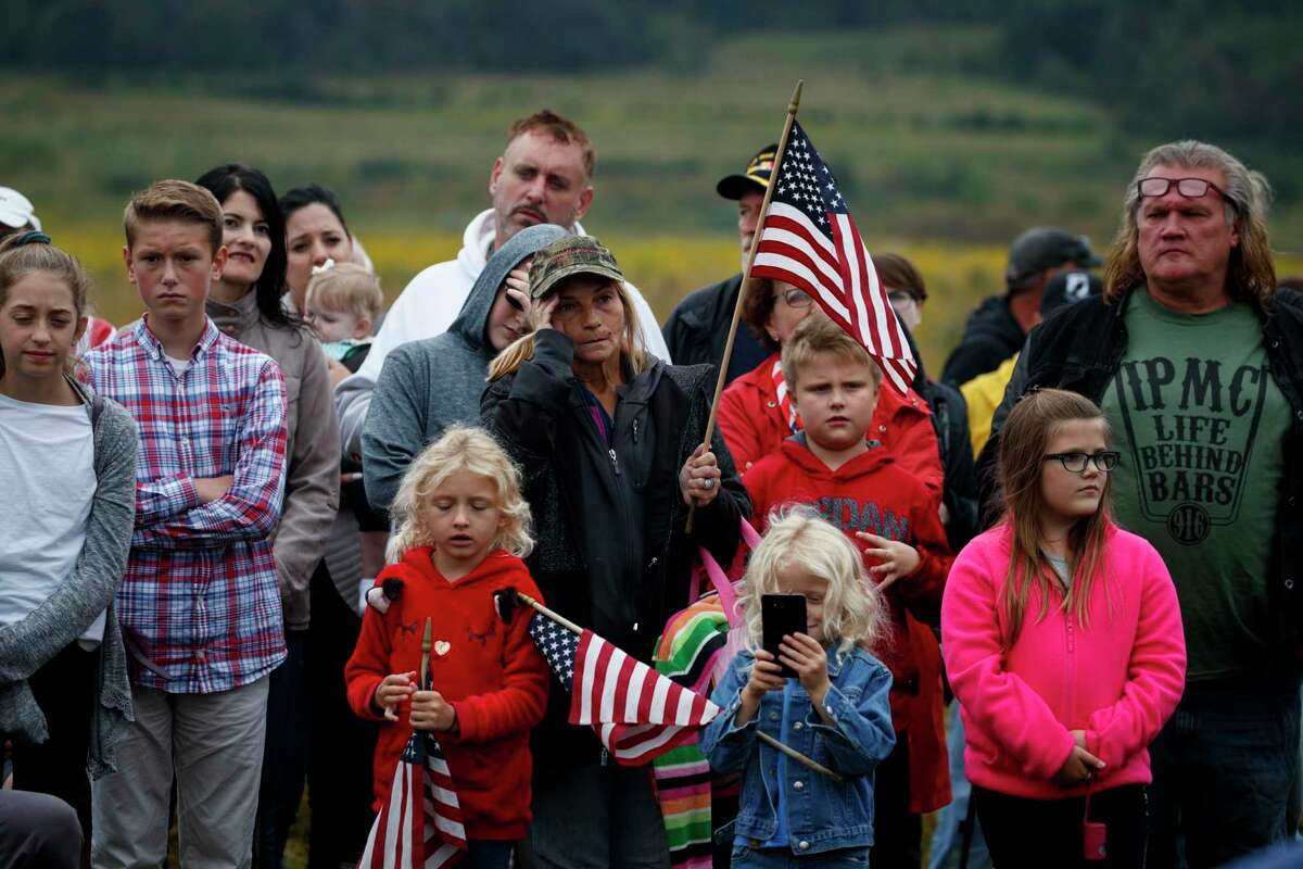 People look on during the September 11th Flight 93 Memorial Service, Tuesday, Sept. 11, 2018, in Shanksville, Pa.