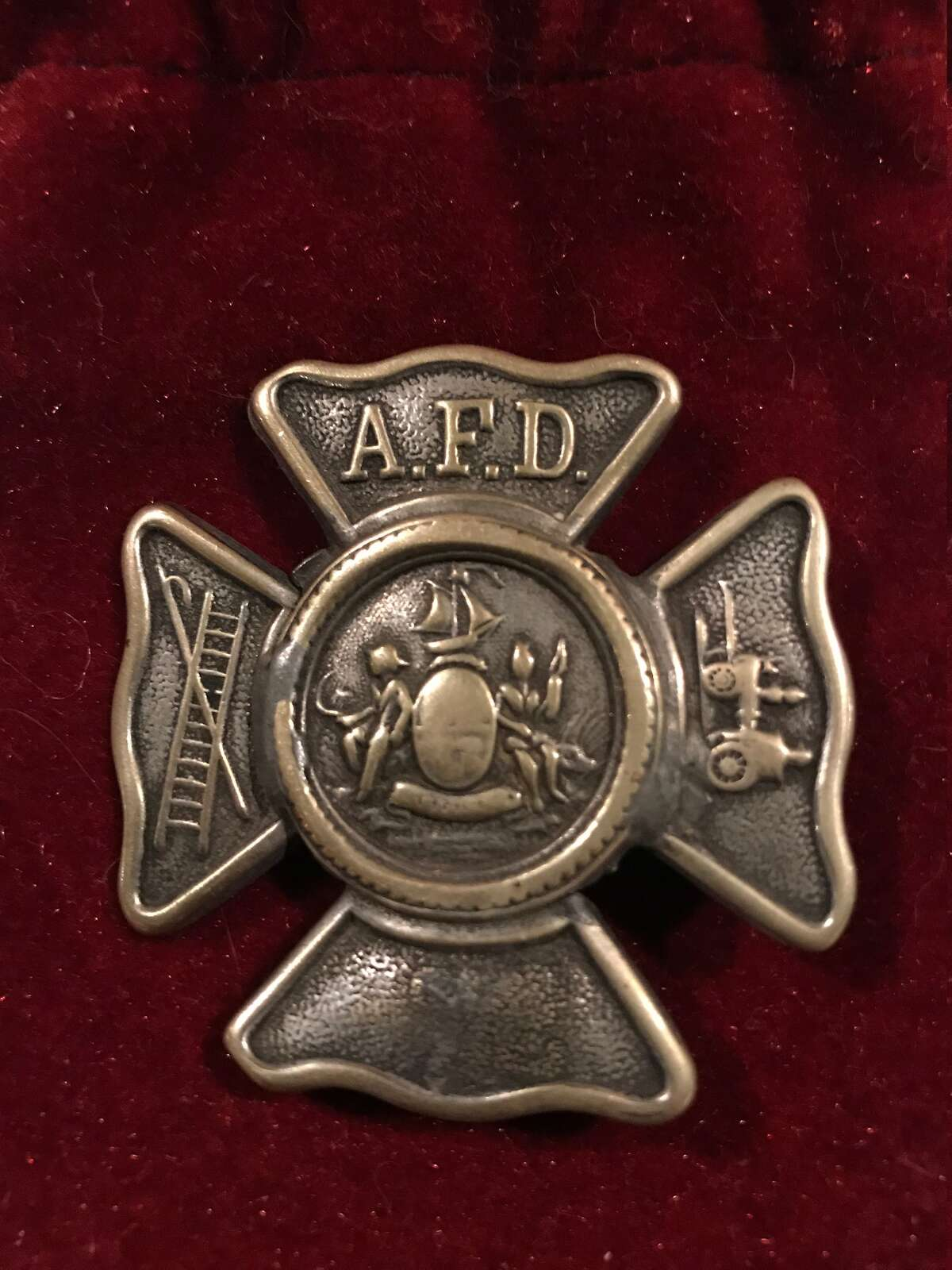 An early Albany Fire Department badge donated to the Albany Firefighters Museum, a work in progress (Paul Grondahl / Times Union)