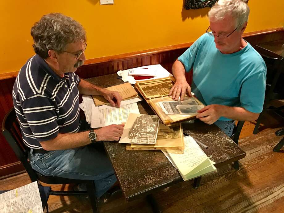 Albany city historian Tony Opalka, left, and Bill Tobler, a retired Albany Fire Department lieutenant, look over memorabilia that has been donated to the Albany Firefighters Museum. Photo: Paul Grondahl / Times Union