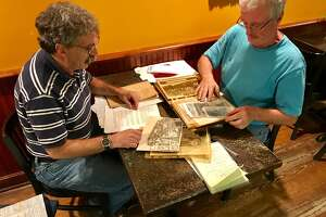 Albany city historian Tony Opalka, left, and Bill Tobler, a retired Albany Fire Department lieutenant, look over memorabilia that has been donated to the Albany Firefighters Museum.