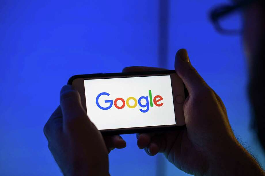 The logo of Google, as seen on a smartphone. Photo: Bloomberg Photo By Jason Alden / Bloomberg