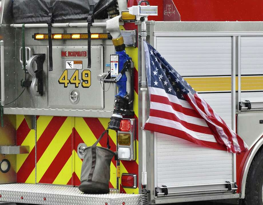 As the nation mourns the tragedy of the Sept. 11, 2001 terror attacks, the Shaker Road Fire Department's Engine 449 uses the flag to show respect. Photo: Skip Dickstein / Times Union