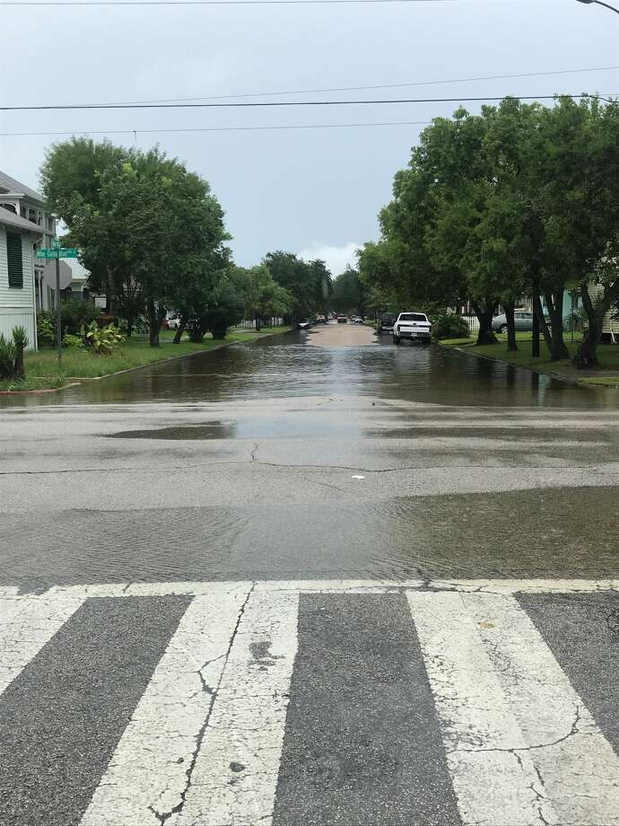 Cars navigate flooding Sept. 11, 2018 at 39th Street and Avenue O in Galveston. Photo: Nick Powell/Houston Chronicle