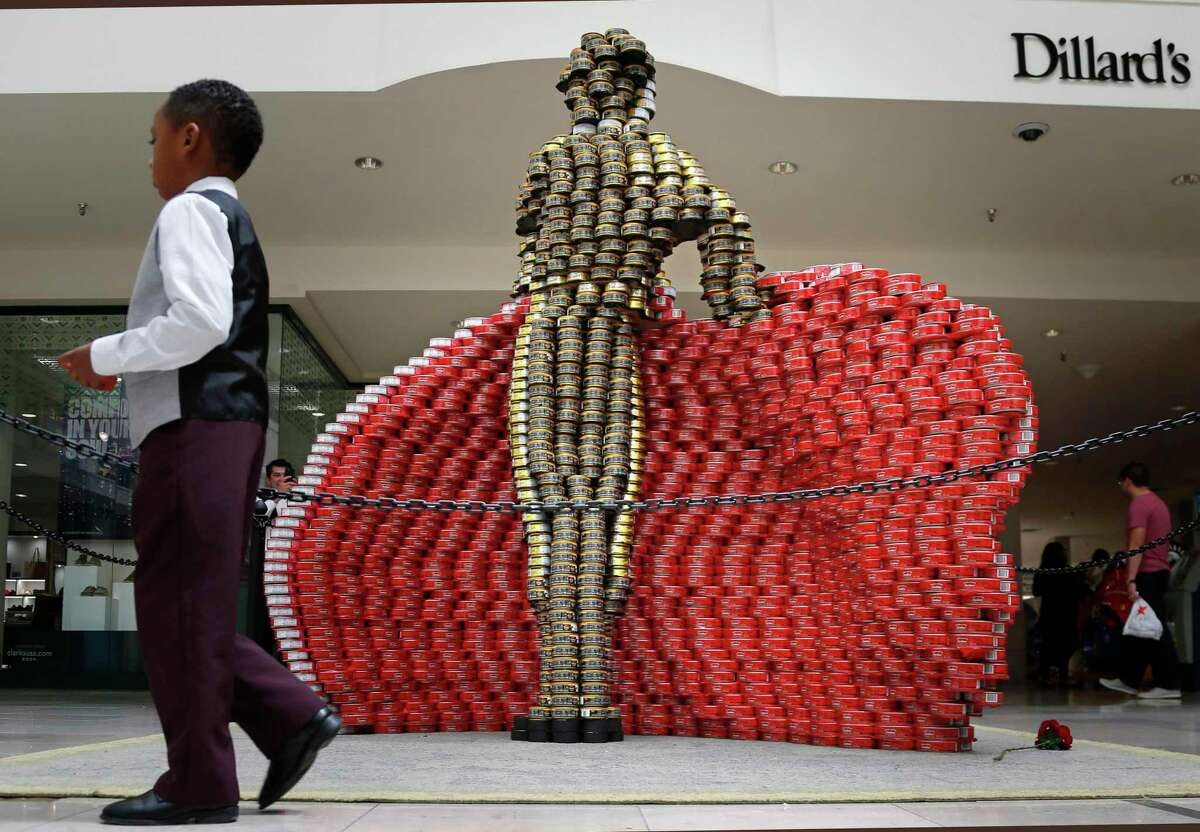 """In last year's Canstruction, Alamo Architects and Turner Construction won first place for Best Original Design from among 1,000 entries worldwide for their sculpture """"The Ban of Hunger,"""" which featured a larger-than-life matador standing behind his flowing red cape."""