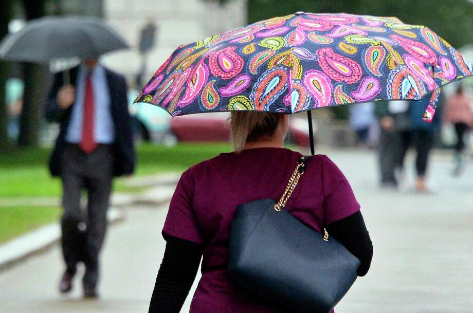Umbrellas are still the order of the day Tuesday morning Sept. 11, 2018 in Albany, NY.  (John Carl D'Annibale/Times Union) Photo: John Carl D'Annibale, Albany Times Union