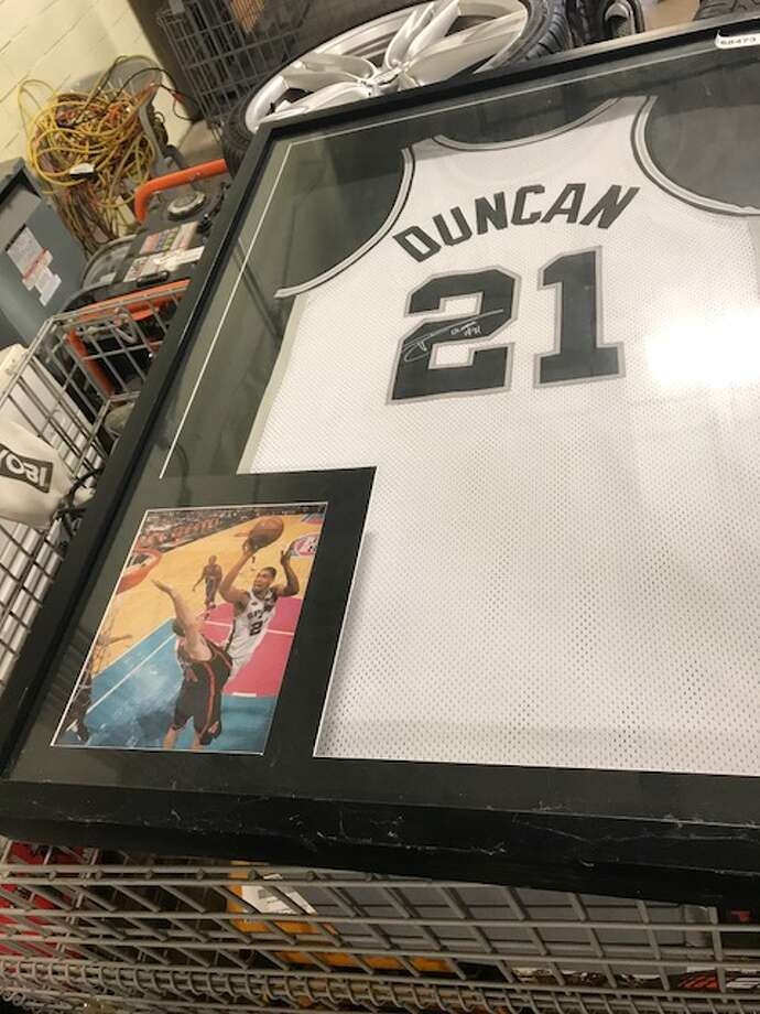 A framed and signed Tim Duncan jersey is up for auction by San Antonio police. Photo: San Antonio Police Department