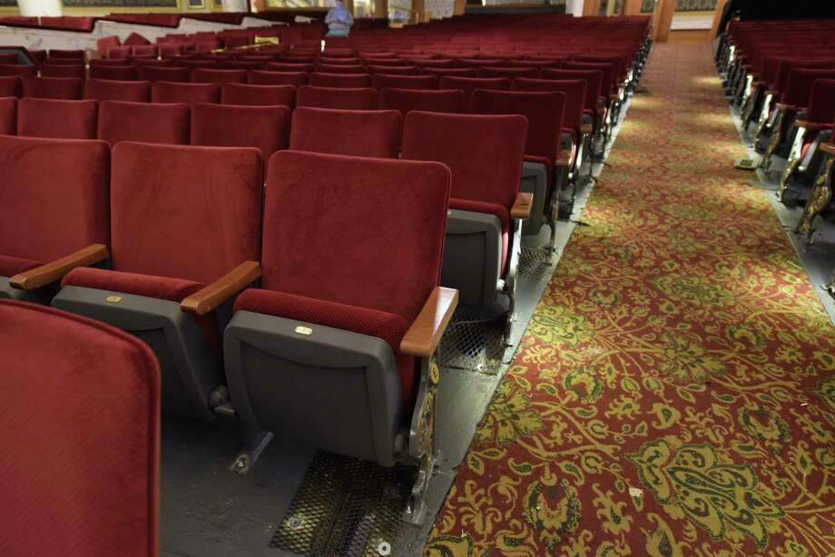 A view of the newly installed seats inside Proctors on Tuesday, Sept. 11, 2018, in Schenectady, N.Y. The new seats were part of a modernization project which included a new hearing loop. The loop will offer much improved clarity for persons with hearing loss who wear telecoil—or T-coil—equipped hearing aids. The new seats have wooden backs and charcoal grey and gold end standards facing the aisles and matching the carpet. The seats are wider, starting at 19 inches as opposed to old seats which were 17.   (Paul Buckowski/Times Union) Photo: Paul Buckowski, Albany Times Union / (Paul Buckowski/Times Union)