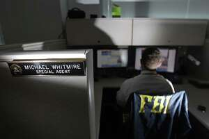 FBI special against Michael Whitmire, who was working on an unrelated case, is assigned to the Houston Area Child Exploitation Task Force at the FBI Houston Division Headquarters, 1 Justice Park Place, on Sept. 12, 2013, in Houston. He works undercover online posing as a child to catch online adult predators who try to entice children into engaging in online sex as well as exchanging explicit photos and videos, and in some cases, meeting in person for sex. ( Melissa Phillip / Houston Chronicle )
