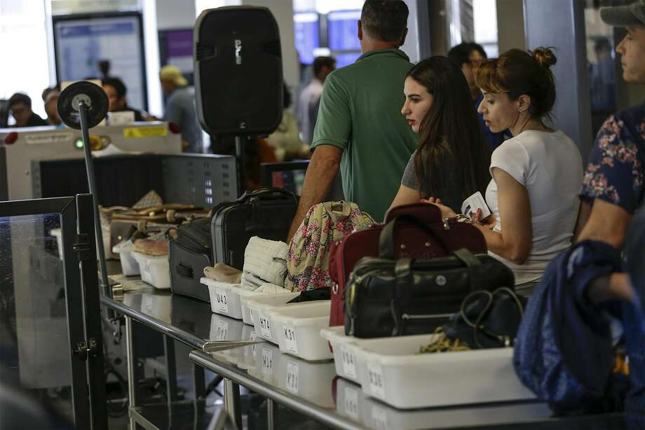 In this file photo, travelers line up at a TSA checkpoint at the United Airlines Terminal at LAX on Friday, May 27, 2016. The TSA will allow liquids and laptops to remain in bags in many airports. (Robert Gauthier/Los Angeles Times/TNS) Photo: Robert Gauthier, TNS