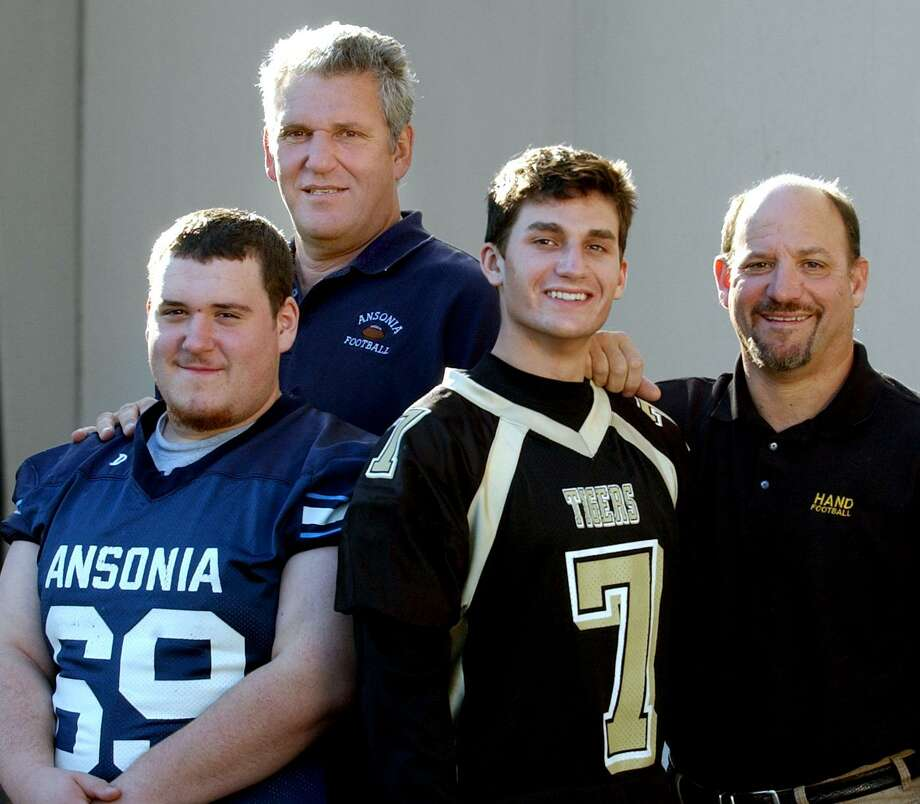 Jeff Hunt and his dad Ansonia football coach Jack Hunt pose with fellow father son duo, and Kevin Filippone and his dad, Hand High School football coach Steve Filippone in 2005. On Friday, the practice field at Jarvis Field in Ansonia will officially be named the Jack Hunt Memorial Practice Field. Photo: Mara Lavitt / Hearst Connecticut Media File